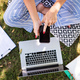 Unrecognizable woman working in home office outdoors in garden, using smartphone and laptop - PhotoDune Item for Sale