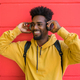 Young afro man listening to music with headphones. - PhotoDune Item for Sale
