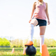 Young female soccer player practicing on field. - PhotoDune Item for Sale