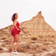 Young woman on a red dress on the desert - PhotoDune Item for Sale