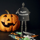 Metal mannequin holding sign with pumpkin - PhotoDune Item for Sale