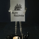 Wire mannequin holding halloween card with candle - PhotoDune Item for Sale