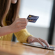 Young women are using a laptop for online shopping and credit card payments. - PhotoDune Item for Sale