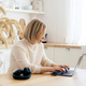 Woman working at home in the kitchen wirelessly in a laptop. - PhotoDune Item for Sale