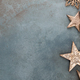 Frame border made of Christmas decorations, golden stars on vintage background. - PhotoDune Item for Sale