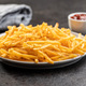 French fries. Fried mini potato sticks on plate. - PhotoDune Item for Sale