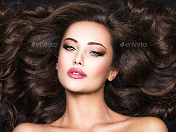 Beautiful woman with long bown hair - Stock Photo - Images