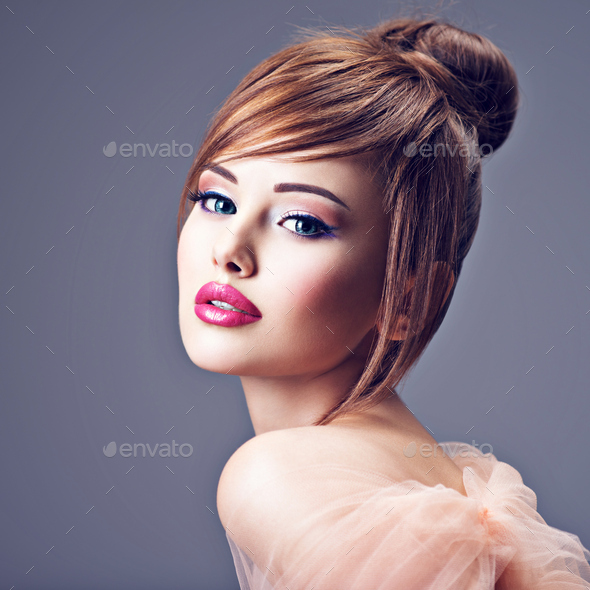 Beautiful redhead girl with style hairstyle. - Stock Photo - Images