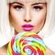 Face of a beautiful  girl with pink make-up and multicolor sweet candy. - PhotoDune Item for Sale