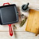 Empty cast iron pan and cutting board - PhotoDune Item for Sale