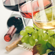 Glasses of white, red and rose wine and grapes - PhotoDune Item for Sale