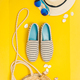 Flat lay traveler accessories on yellow background with straw hat, summer shoes, bag and sunglasses - PhotoDune Item for Sale