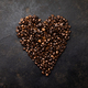 Coffee beans in shape of heart on dark rustic background - PhotoDune Item for Sale