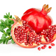 Pomegranate with leaves isolated on white background. - PhotoDune Item for Sale