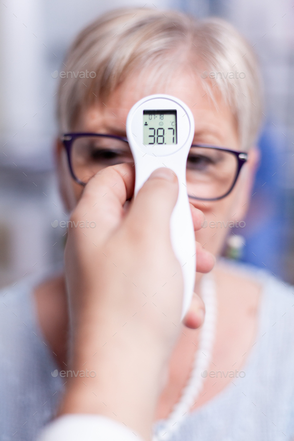 Thermometer showing body temperature - Stock Photo - Images