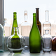 various empty bottles on sill of home window - PhotoDune Item for Sale