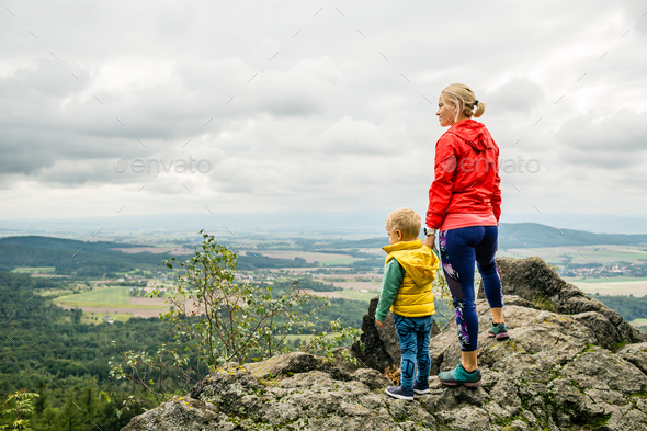 Mother with little boy travelling in mountains - Stock Photo - Images