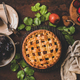 Flat-lay of whole apple and plum pie and tea setting - PhotoDune Item for Sale