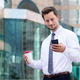 Young businessman holding with cellphone and coffee - PhotoDune Item for Sale
