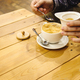 beautifl stylish amazing latte on a wooden desk and man's hands putting sugar in a  coffee cup - PhotoDune Item for Sale