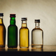 different alcohol bottles are on the table on a light background - PhotoDune Item for Sale