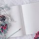 Christmas concept. White notebook with christmas decoration, wreath on a white background. Flat lay - PhotoDune Item for Sale