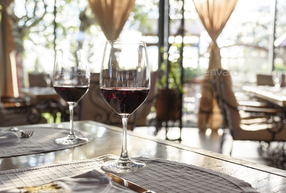 Wine glasses on restaurant table - Stock Photo - Images