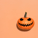 Halloween pumpkin in hand on orange background - PhotoDune Item for Sale