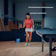 Woman hits a ball, table tennis training in gym - PhotoDune Item for Sale