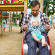 Happy parents play with little baby on playground - PhotoDune Item for Sale