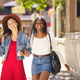 Two female walking together on the street. Multiethnic friends - PhotoDune Item for Sale