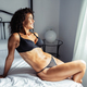 Middle-aged woman In lingerie posing on the bed - PhotoDune Item for Sale