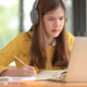 Teenage girls wear headphones to study online and take lectures. - PhotoDune Item for Sale