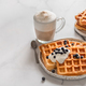 Breakfast belgian waffles, cappuccino. Copy space - PhotoDune Item for Sale