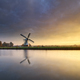 beautiful sunrise over Dutch windmill by river - PhotoDune Item for Sale
