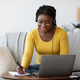 Online Education. Smiling Black Woman In Headset Studying With Laptop At Home - PhotoDune Item for Sale