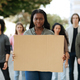 Black woman with empty placard leading group of protestors - PhotoDune Item for Sale