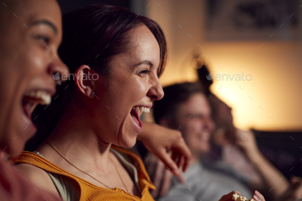 Group Of Gay Friends Sitting On Sofa At Home Watching Evening TV And Relaxing Together - Stock Photo - Images