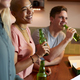 Group Of Friends Celebrating With Beers Meeting At Home And Eating Takeaway Pizza - PhotoDune Item for Sale