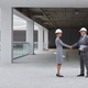 Two Business People Shaking Hands at Construction Site - PhotoDune Item for Sale