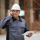 Mature Construction Worker Speaking by Phone - PhotoDune Item for Sale