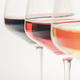 Glasses of white, red and rose wine over white background, close up - PhotoDune Item for Sale