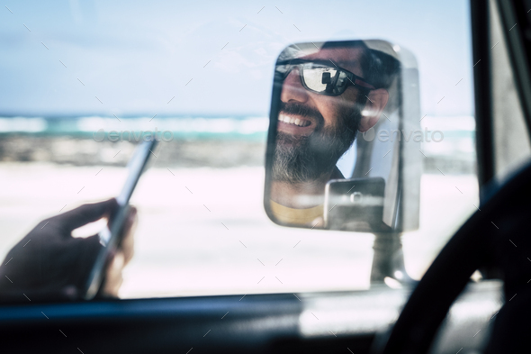 close up of young man travel with car - Stock Photo - Images