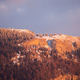 Winter nature scenery with a rocky mountainside covered with snow at sunset - PhotoDune Item for Sale