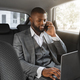 Happy black businessman talking on mobile phone in car - PhotoDune Item for Sale