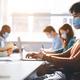 International people wearing medical masks using laptop - PhotoDune Item for Sale