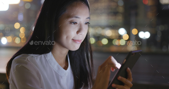 Asian Woman use of cellphone in city - Stock Photo - Images