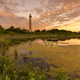 Sunset over lighthouse - PhotoDune Item for Sale