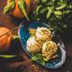 Scoops of Turkish dessert semolina helva with pistachio, mint, tangerines - PhotoDune Item for Sale