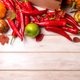 Fall background with red hot chili peppers, apples - PhotoDune Item for Sale